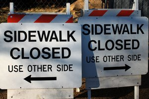 Confusing Sidewalk Signs © https://www.flickr.com/photos/mr_t_in_dc/